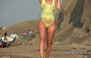 Finished swimsuit with a difficulty addition of unembellished gold-brick