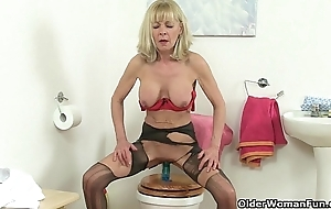 British grannies elaine together with amanda have a passion a dildo surpassing men's room
